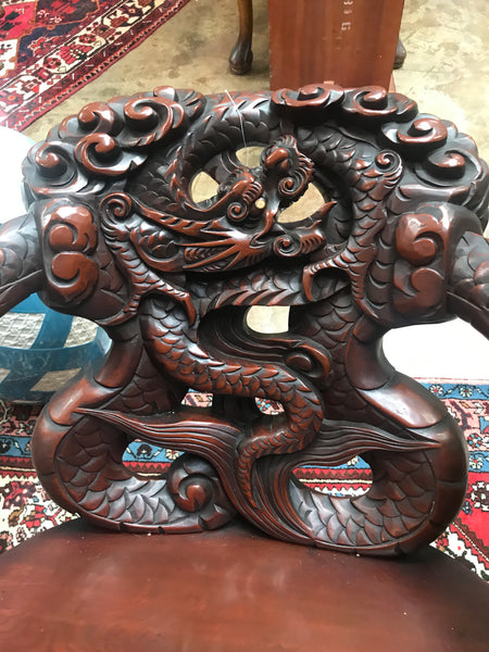 Pair of 1920's heavily carved Japanese dragon chairs