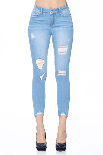 light wash distressed mid rise skinny jeans