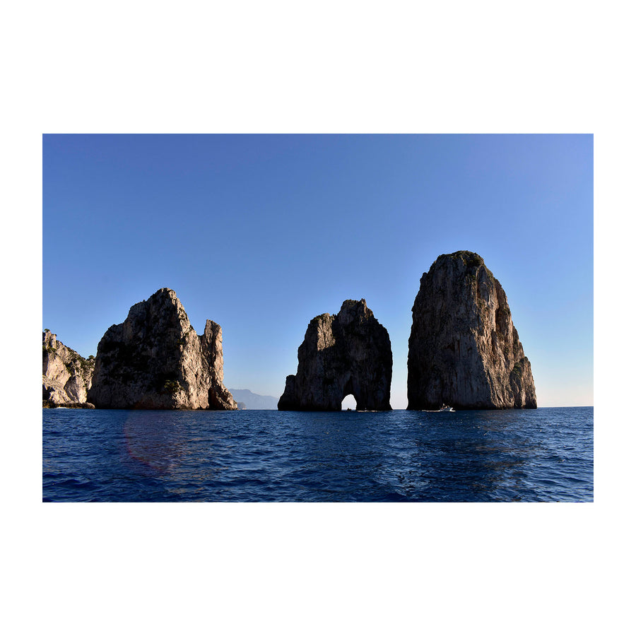 Sailing through Capri's Faraglioni