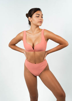 pink v wire bikini top with high waisted bottoms