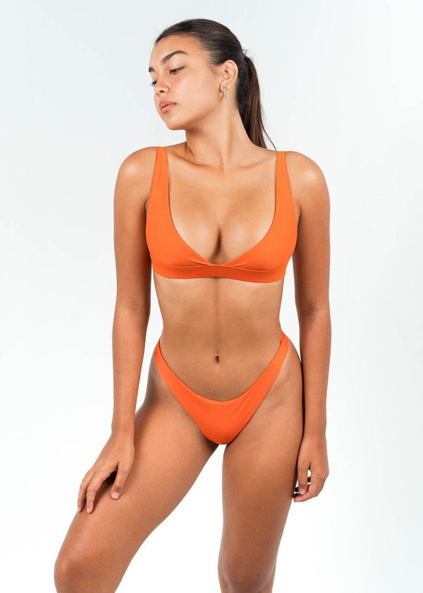 orange bikini crop top with high cut bottoms