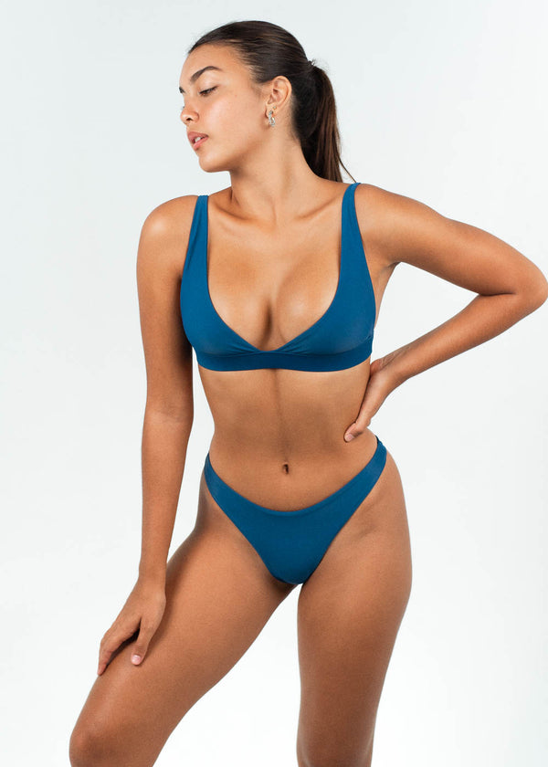 blue bikini crop top with high cut bottoms