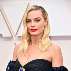 Margot Robbie Old-Hollywood glamour ruled the Oscars red carpet and soft waves  — may just be our favorite.