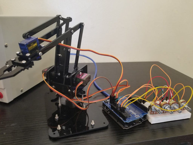 Controlling 4DOF Robotic Arm Claw Kit with 16 channel PWM/Servo Shield using analog input.