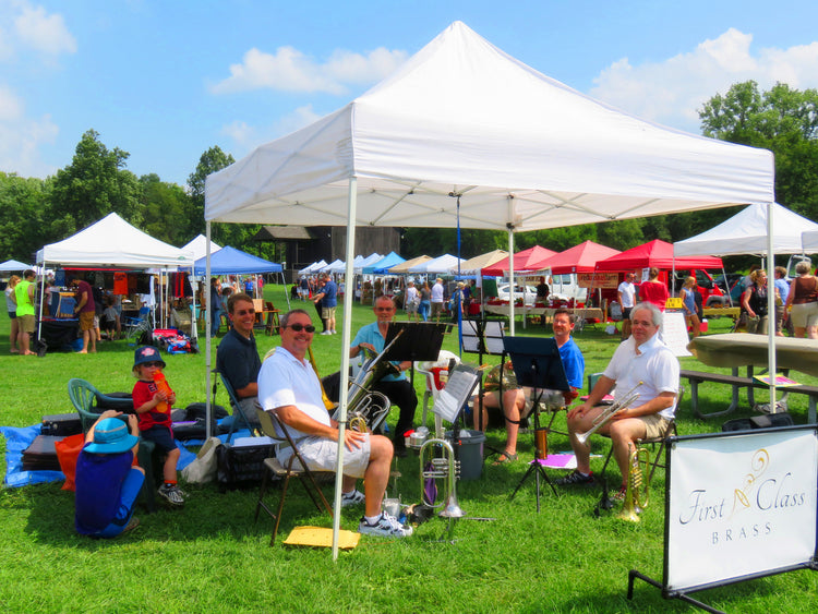 craft show sheltered by pop up canopy