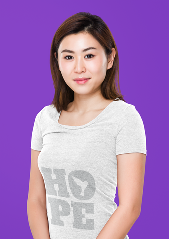 East Asian lady wearing gray shirt that says Hope