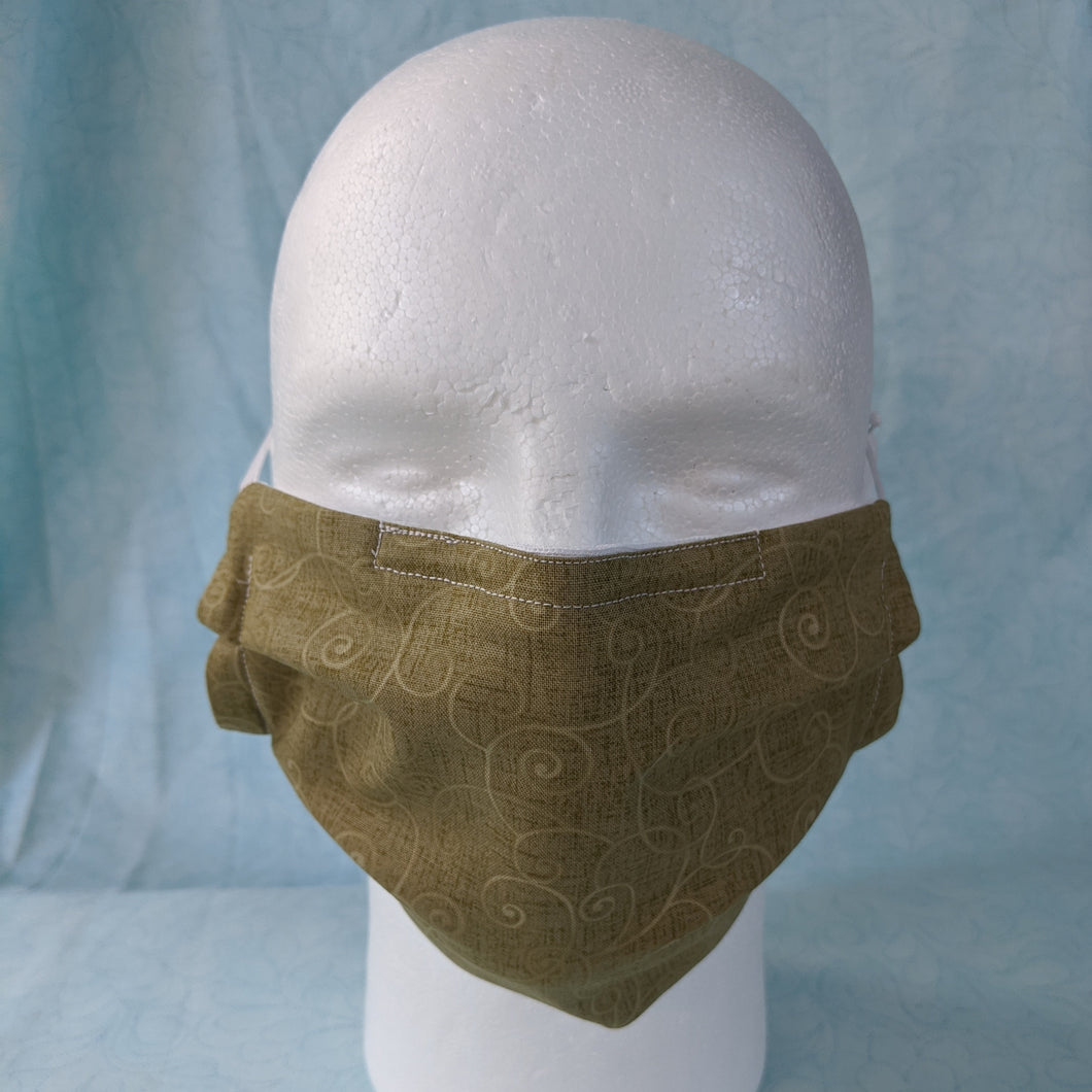 Comfort Fit - Green Swirls face mask front view.