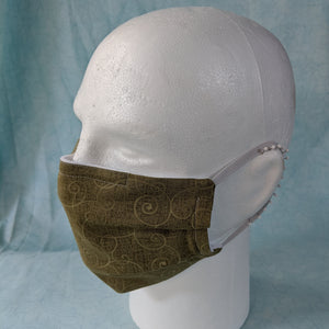 Comfort Fit - Green Swirls face mask side view.