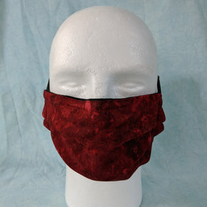 Comfort fit red abstract face mask front view.