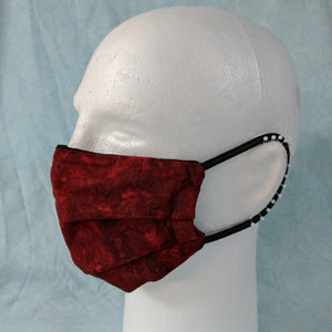 Comfort fit red abstract face mask side view.