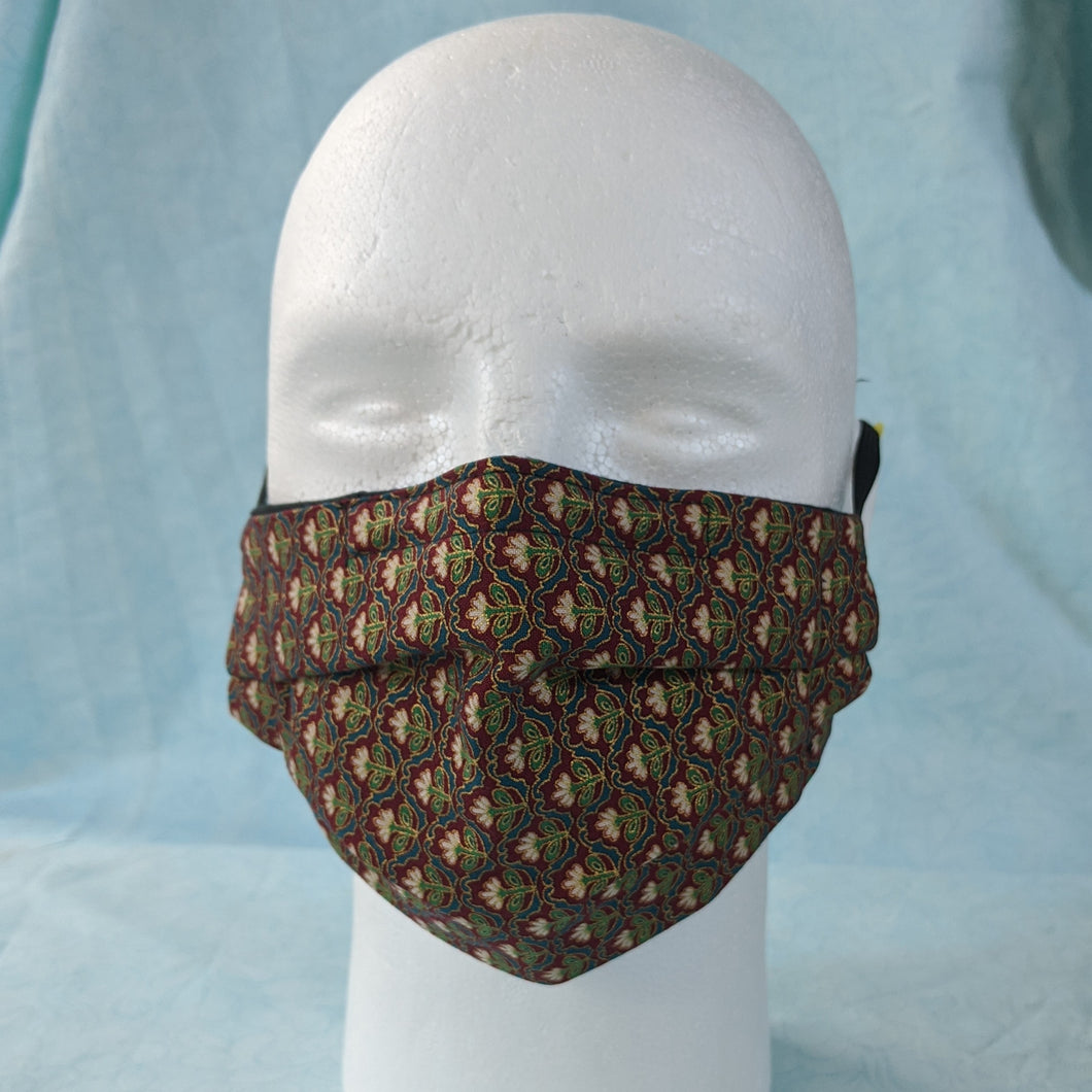 Wine coloured face mask with flower print front view.