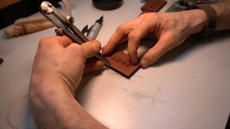 Marking leather patch to sew.