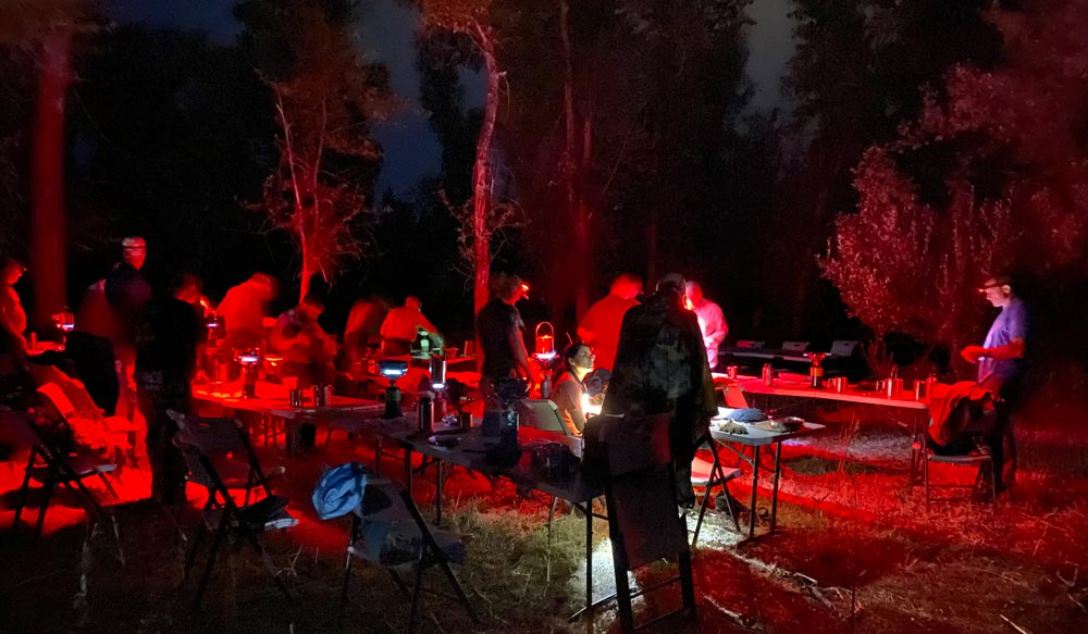 Nighttime cooking with head lamps at GB2 Wilderness Skills course