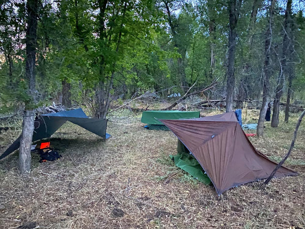 Improvised tarp shelters at GB2 Wilderness Skills course