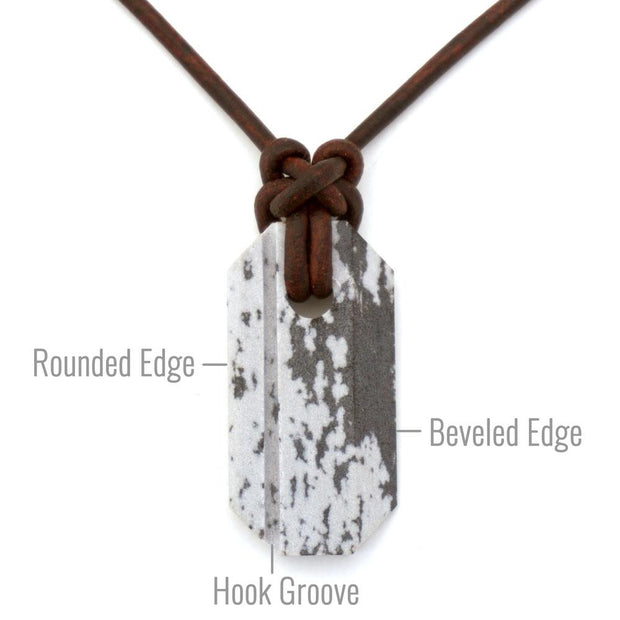 front view of whetstone necklace pointing out the edges and grooves for sharpening different tools