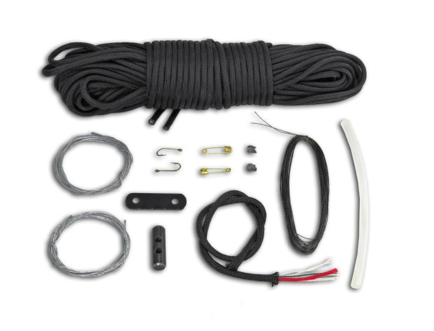 Components inside 550 paracord braided survival kit belt