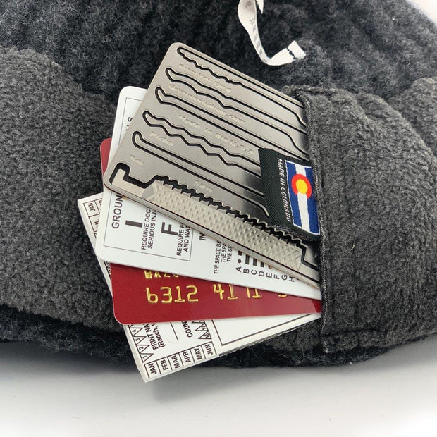 Cache Beanie by Wazoo with four credit card sized items in pocket