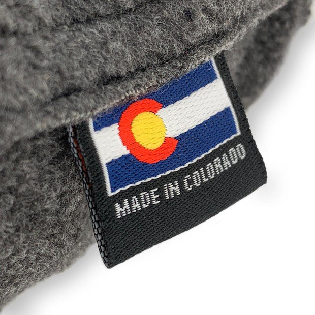 Cache Beanie made in colorado tag that doubles as pull tab to open pocket