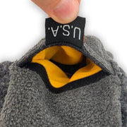 Cache Beanie made in USA pull tag to open hook and loop pocket with contrasting orange interior