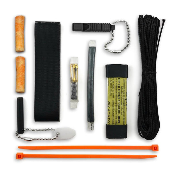 15 tool survival kit laid flat with whistle tinder plugs ferro rod scraper and coradage