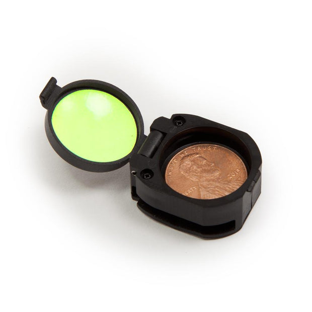black clamshell container and reflective glow light on the inside of lid with compass removed and penny in the place of the compass for size