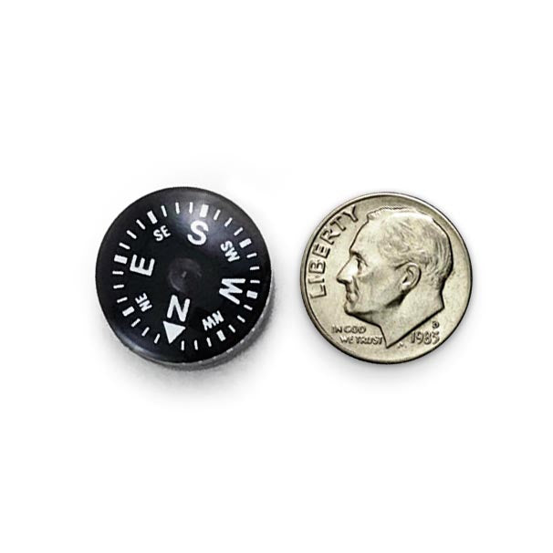 Mini survival button compass compared to US dime