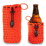 Paracord beverage skin pouch with whistle ferro rod and ceramic scraper