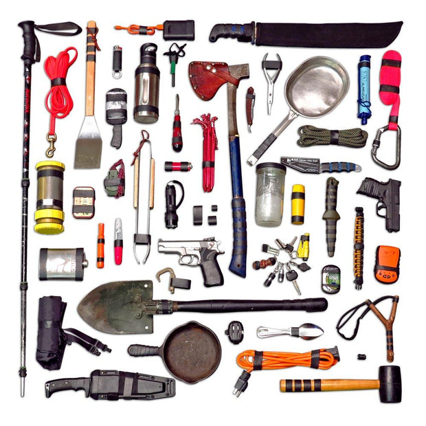 flay lay of tools including shovels, knives, axes, and rope that have ranger bands added to them