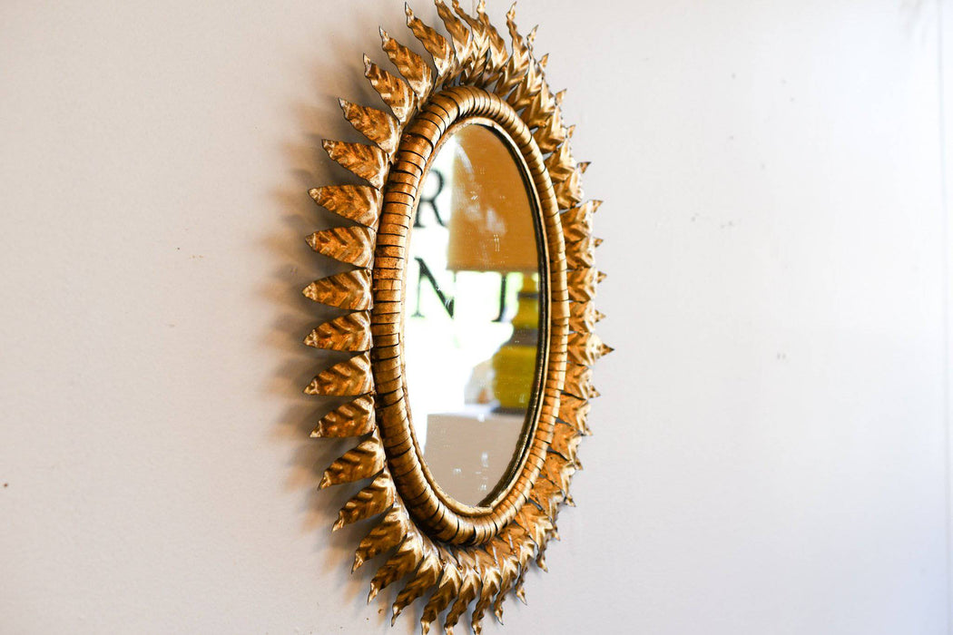 An Oval 1920s French Gilded Metal Starburst Mirror - Greystones Antiques
