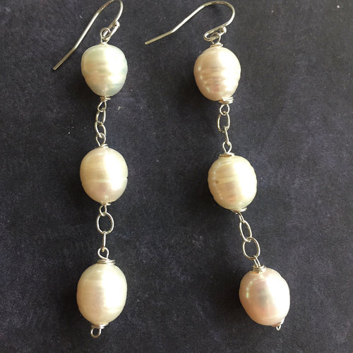 big pearl earrings