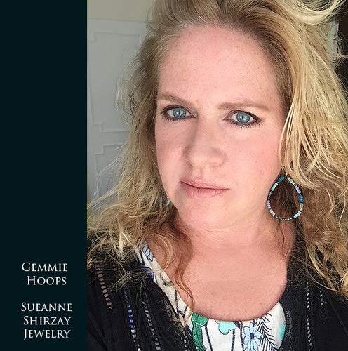 Sueanne Shirzay Wearing gemstone hoop earrings
