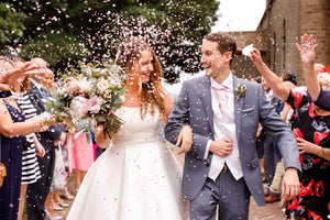 Bride and groom leaving Church in a shower of confetti.  Union Cakes Manchester