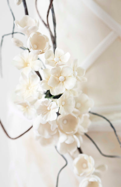 Delicate handmade white sugar blossom detail from contemporary beach inspired wedding cake
