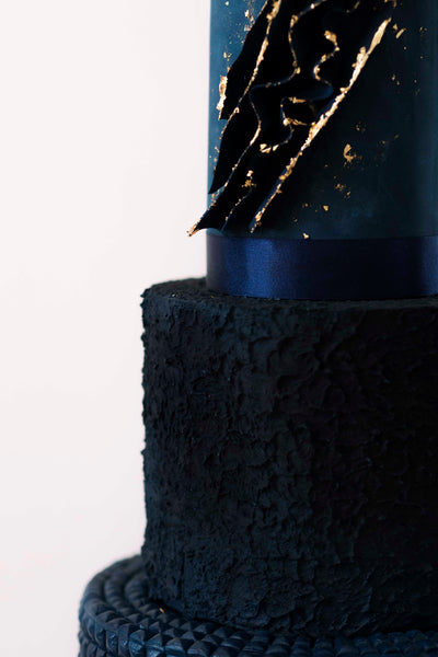 Deep blue 3 tier modern textured wedding cake made in Manchester, England.