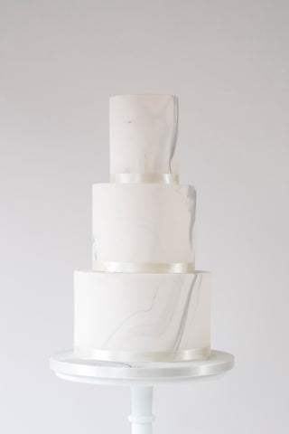 Not quite naked wedding cake with marbled finish