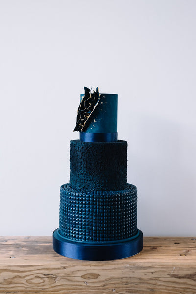 Great value contemorary navy blue textured three tier wedding cake with abstract voile edged in edible gold leaf
