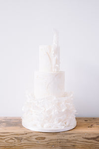 Textured three tier contemporary wedding cake with a modern ruffle and ethereal feel