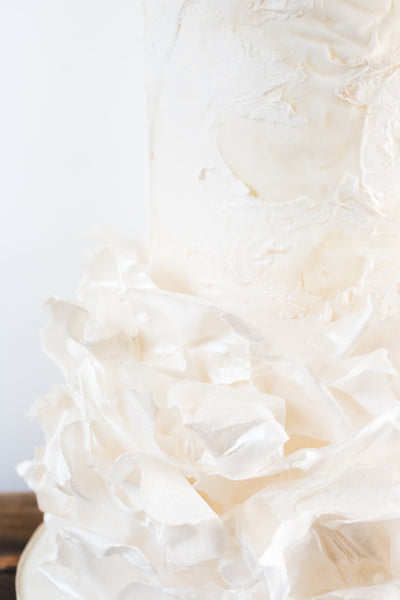 Contemporary wedding cake with modern ruffle, textured finish and dreamy ethereal look