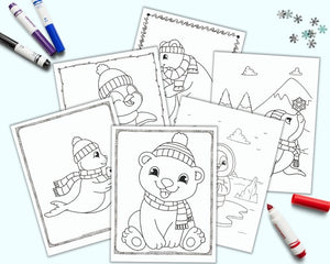 A flatlay mockup with 6 printable cute winter animal  coloring pages on a blue background with colorful children's markers. The pages feature polar bears, penguins, and seals.