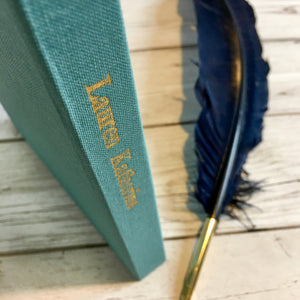 Personalisation in gold foil embossed on teal bookcloth spine