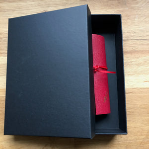 A4 leather wraparound notebook in matt black gift box.