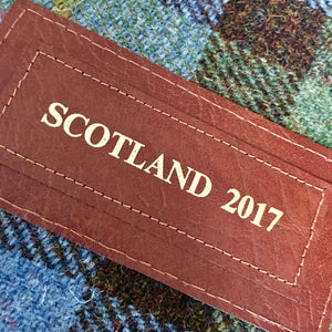 Personalised label with 'SCOTLAND 2017' embossed in gold on a matching leather label