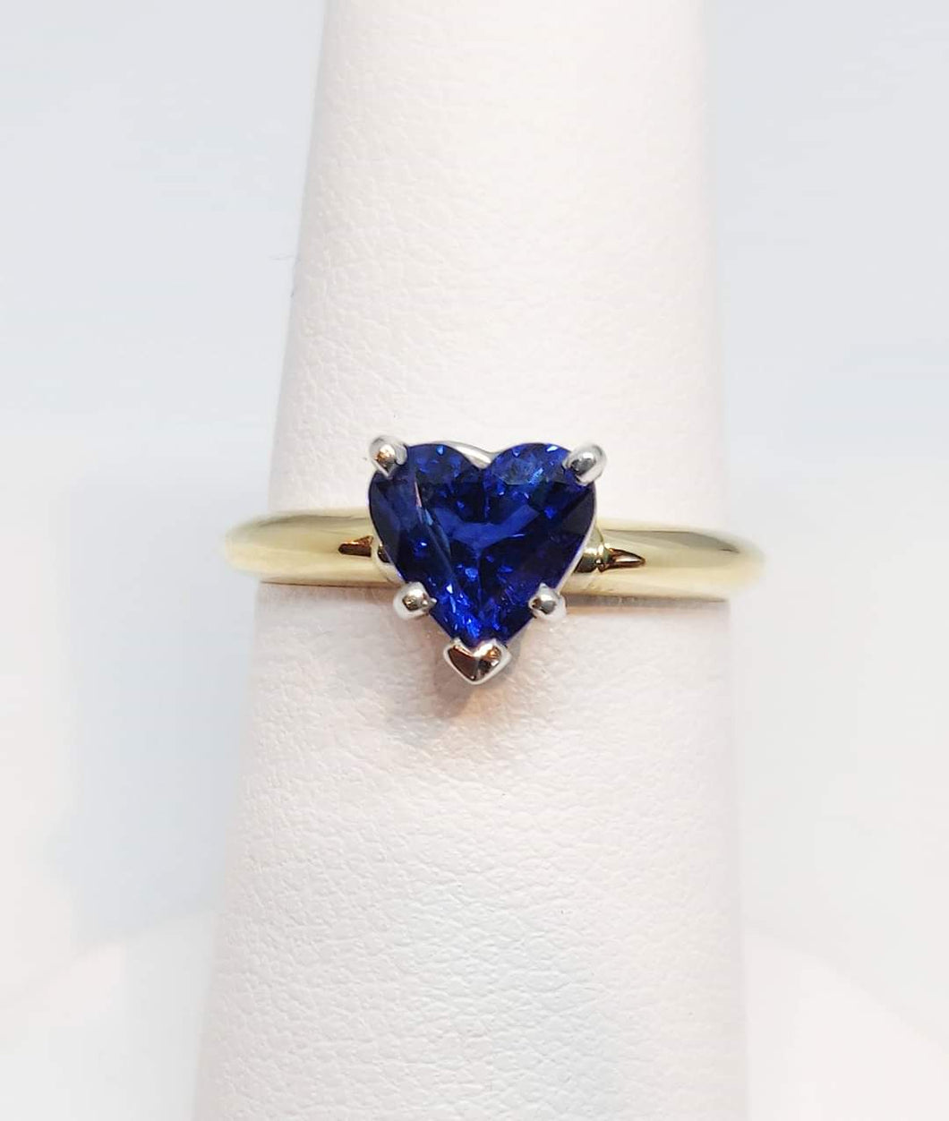 Blue topaz heart shaped solitaire ring