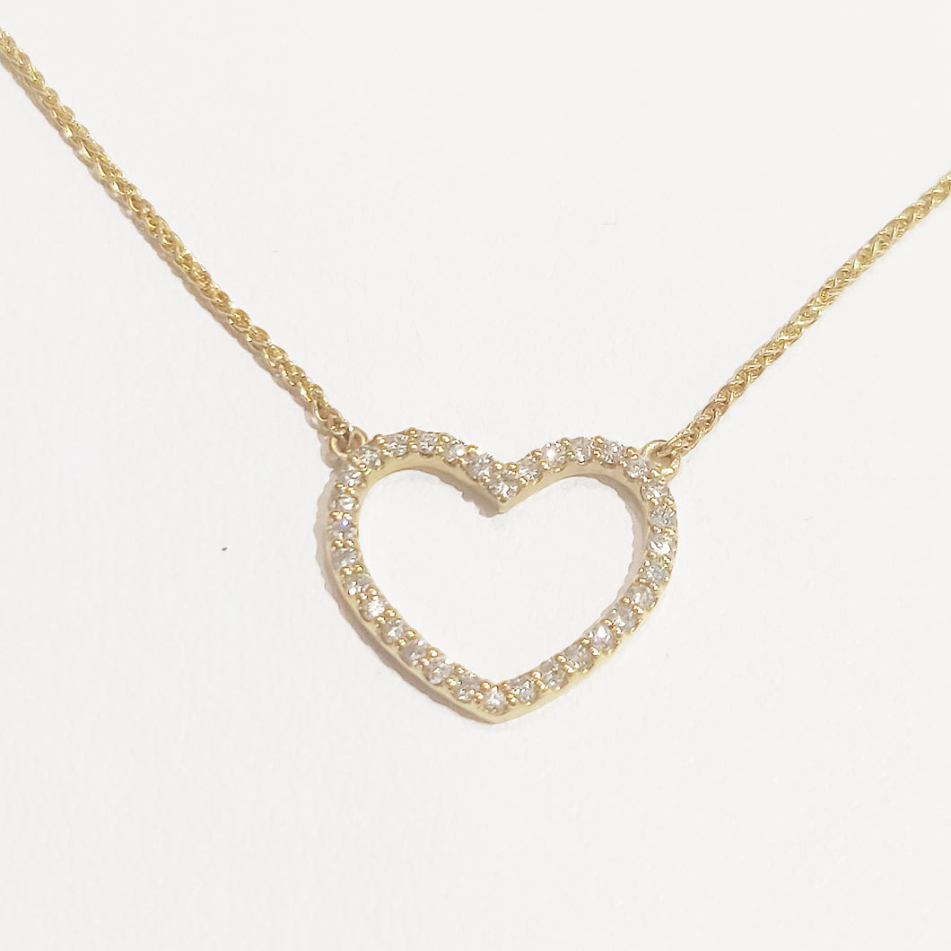 Heart diamond and yellow gold necklace
