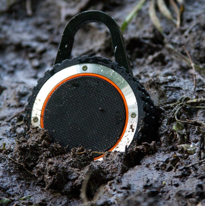 rugged bluetooth speaker in mud,ALL-Terrain Sound, ATS, outdoor bluetooth speaker, waterproof bluetooth speaker, portable bluetooth speaker, waterproof portable speaker, waterproof speaker, portable speaker, waterproof outdoor speaker, waterproof, portable, bluetooth, rugged speaker