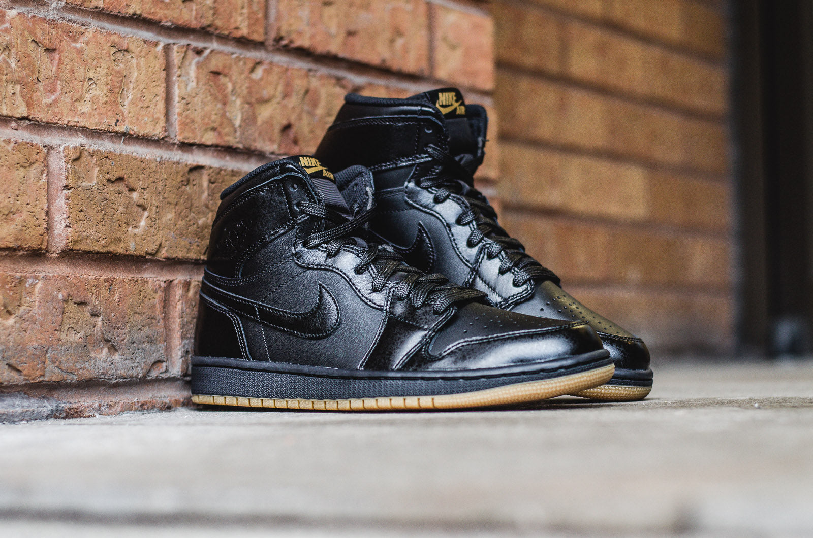 a26acfe079f2cc The time-honored classic Air Jordan 1 Retro High OG gets a monochrome black  leather upper. The Gum Light Brown outsole and Nike Air logo on the tongue  tag ...