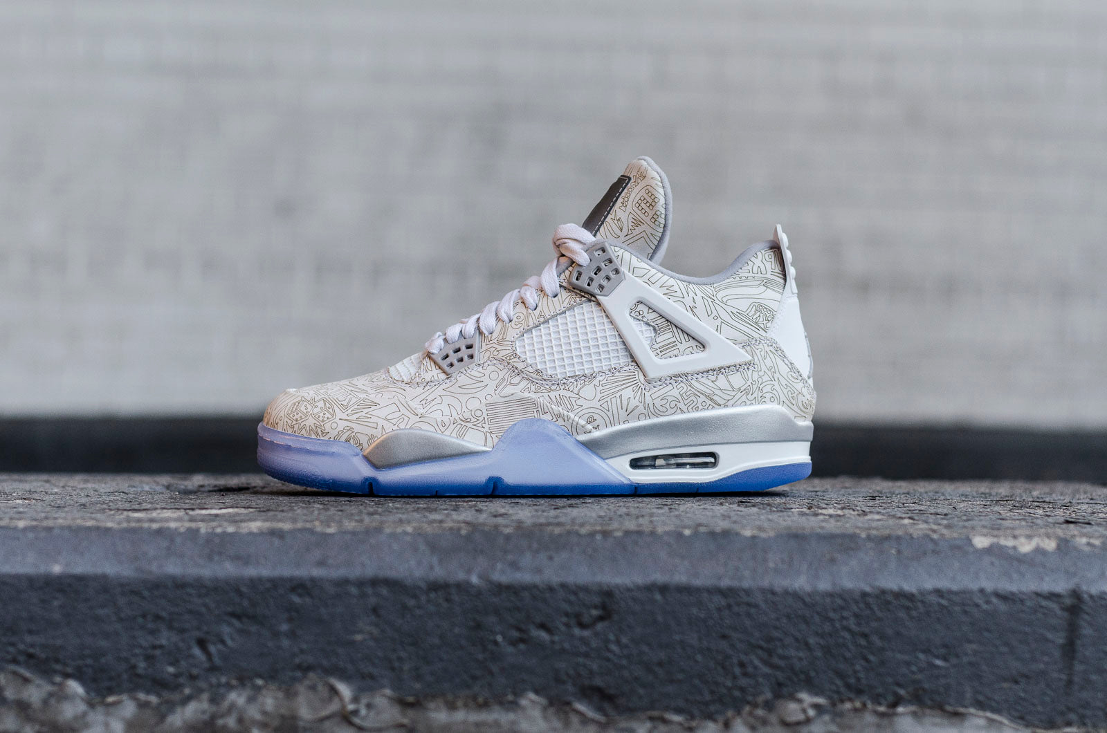 huge selection of b95dd 33e8a A throwback to the early to mid-2000s, the Air Jordan IV Laser returns atop  a premium white upper, tonal leather overlays, and intricate laser-etched  ...