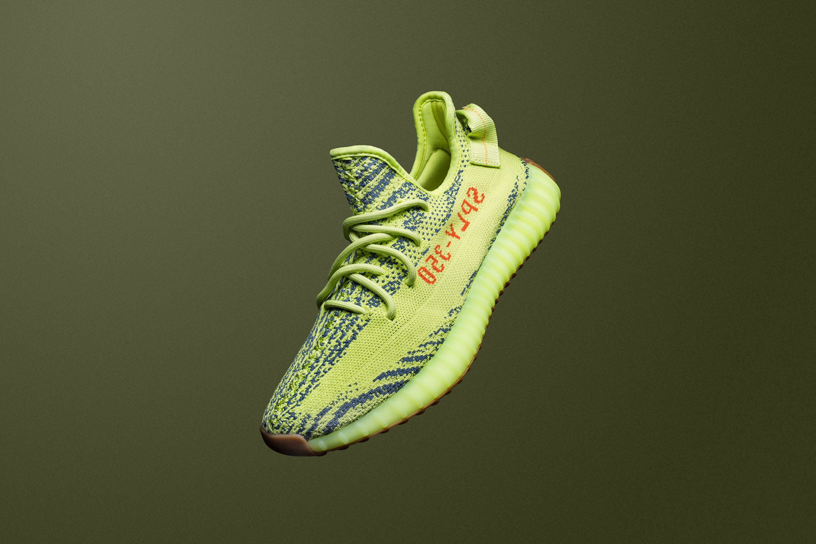 "253bdff0c The Yeezy Boost 350 V2 ""Semi Frozen Yellow"" is back for the holidays in the  audacious ""Frozen Yellow"" colourway. The second gen sneaker features a ..."