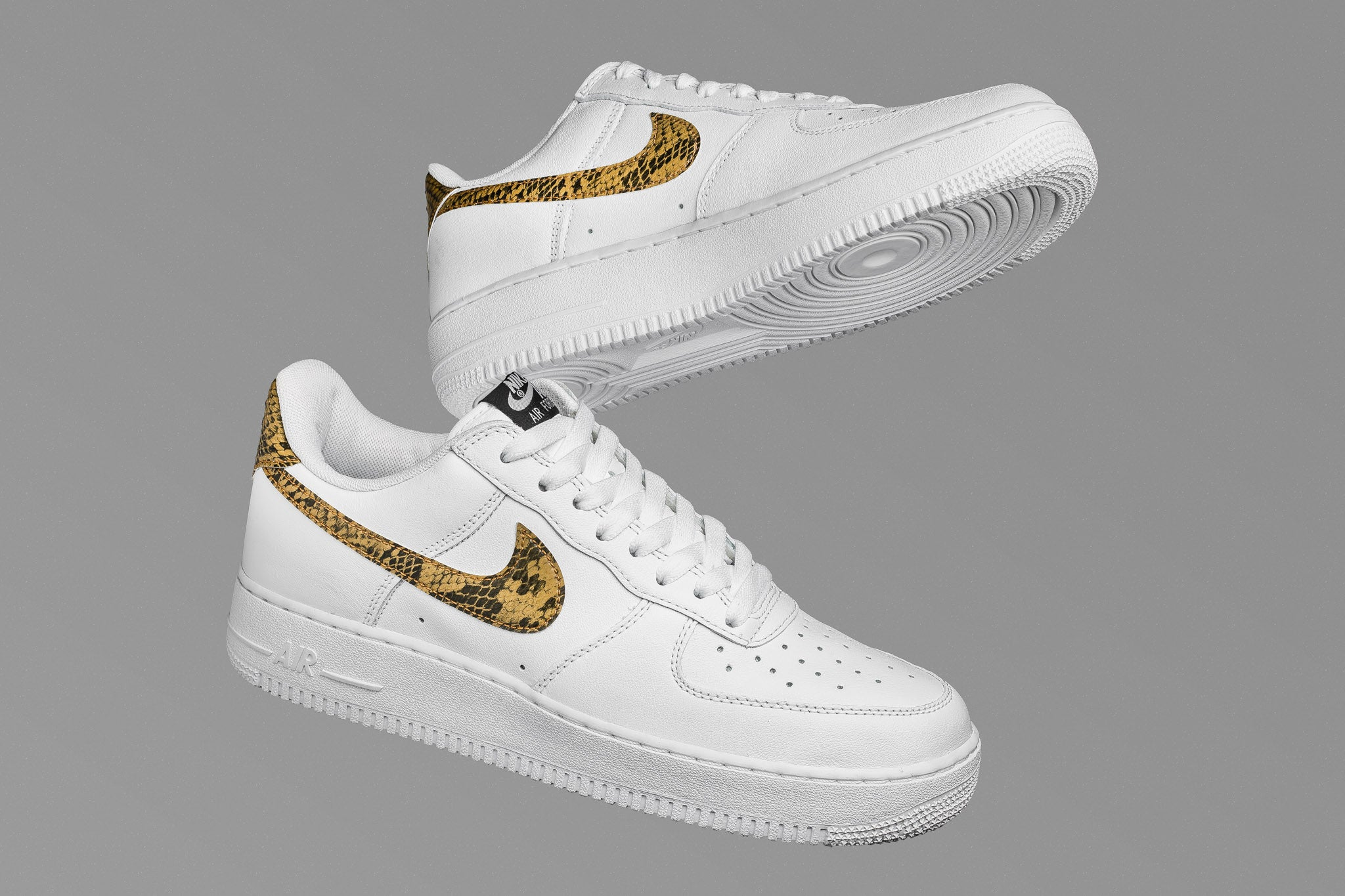 new arrival 921e2 5040c The Air Force 1 Retro PRM adds a luxe beige snakeskin swoosh over top the  premium leather uppers. Arriving in the low-top profile, the Air Force 1  Low Retro ...