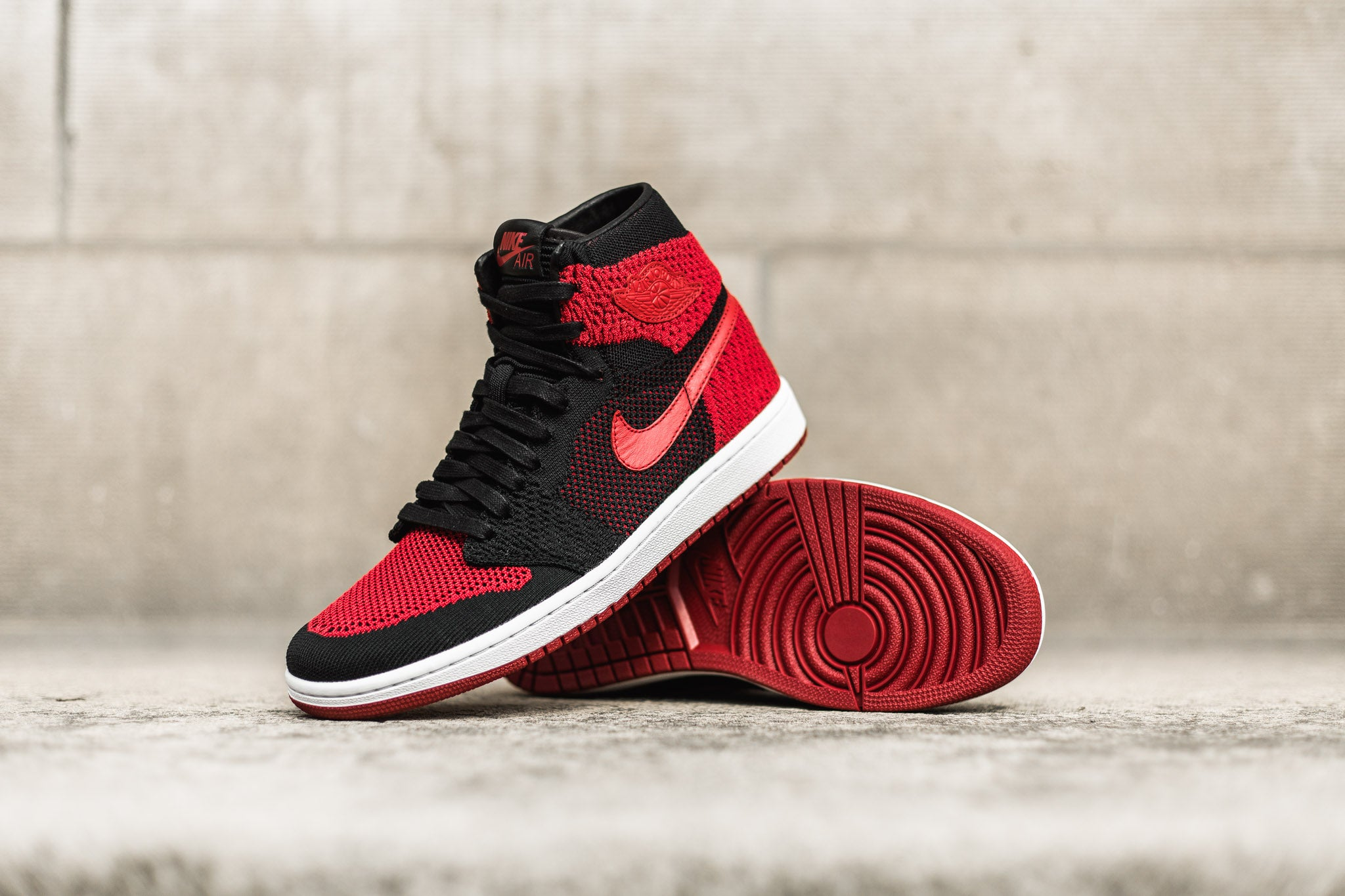 026c30a6a74d ... spain the air jordan 1 retro flyknit banned dresses down the bred with  a full length